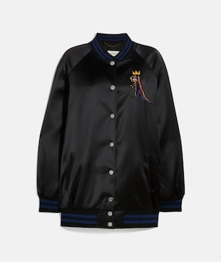 COACH X JEAN-MICHEL BASQUIAT COLLEGE-JACKE IN OVERSIZE
