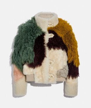 GIUBBOTTO IN SHEARLING A PANNELLI