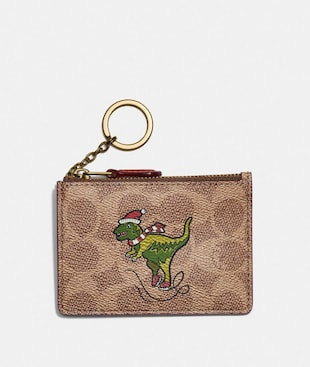 BOXED MINI SKINNY ID CASE IN SIGNATURE CANVAS WITH REXY