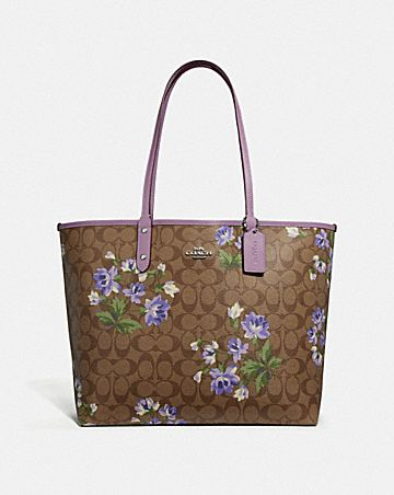REVERSIBLE CITY TOTE IN SIGNATURE CANVAS WITH LILY PRINT