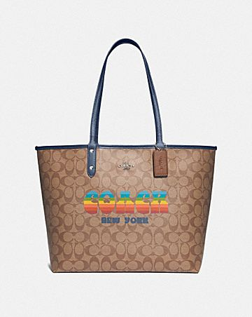 REVERSIBLE CITY TOTE IN SIGNATURE CANVAS WITH RAINBOW COACH ANIMATION