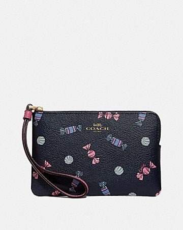 CORNER ZIP WRISTLET WITH SCATTERED CANDY PRINT
