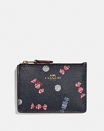 MINI SKINNY ID CASE WITH SCATTERED CANDY PRINT