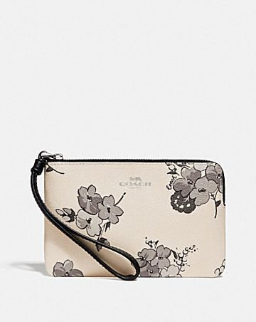 CORNER ZIP WRISTLET WITH FAIRY TALE PRINT
