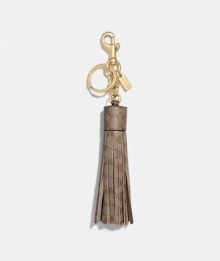 TASSEL BAG CHARM IN SIGNATURE CANVAS