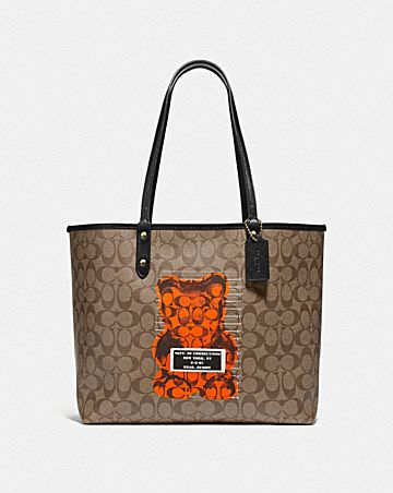 REVERSIBLE CITY TOTE IN SIGNATURE CANVAS WITH VANDAL GUMMY