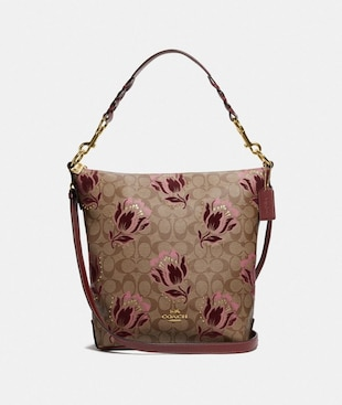 ABBY DUFFLE IN SIGNATURE CANVAS WITH DESERT TULIP PRINT FLOCKING