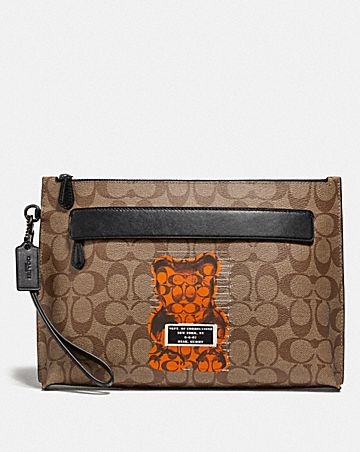 CARRYALL POUCH IN SIGNATURE CANVAS WITH VANDAL GUMMY