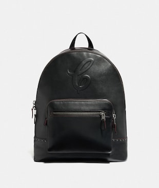 WEST BACKPACK WITH SIGNATURE MOTIF AND STUDS