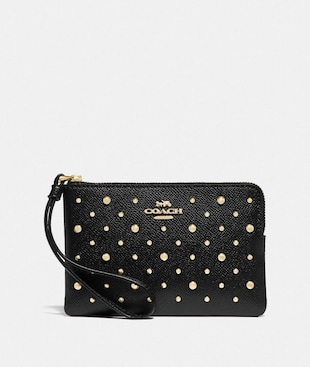 CORNER ZIP WRISTLET WITH RIVETS
