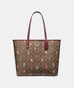 REVERSIBLE CITY TOTE IN SIGNATURE CANVAS WITH PARTY ANIMALS PRINT