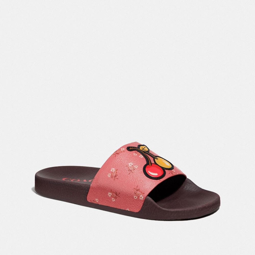 UDELE SPORT SLIDE WITH FLORAL BOW PRINT